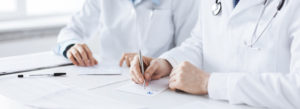 Header-Doctor-with-Paperwork